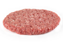 Fresh raw burger  on a white. A fresh raw burger  on a white background with copyspace Royalty Free Stock Image