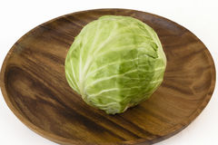 Fresh Raw Cabbage. Single raw cabbage on a wooden dish Royalty Free Stock Photo