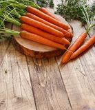 Fresh raw carrots with leaves. On a  wooden table Stock Photography