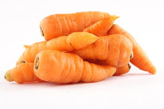 Fresh  raw carrots, in white background. Heap of organic carrots,,,Selective focus Stock Photography
