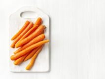 Fresh raw carrots. On white wooden table Royalty Free Stock Photo