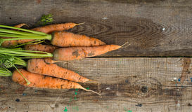 Fresh raw carrots. Carrots on a wooden background Royalty Free Stock Images