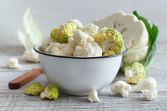 Fresh raw cauliflower. In a bowl on an old wooden table Royalty Free Stock Images