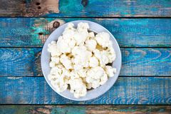 Fresh raw cauliflower in bowl. On a wooden table Royalty Free Stock Photography
