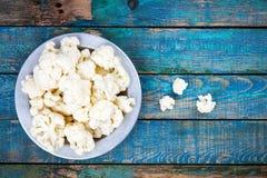 Fresh raw cauliflower in bowl Stock Photo