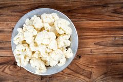 Fresh raw cauliflower in bowl Royalty Free Stock Images