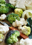Fresh raw cauliflower and broccoli. On an old wooden table Royalty Free Stock Images