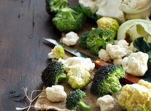 Fresh raw cauliflower and broccoli. On an old wooden table Stock Photography