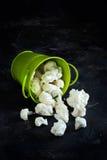 Fresh raw cauliflower. In a bucket on a dark background Royalty Free Stock Photo