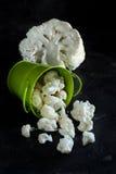 Fresh raw cauliflower. In a bucket on a dark background Royalty Free Stock Photography