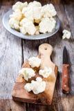 Fresh raw cauliflower on  cutting board Royalty Free Stock Photos