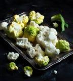 Fresh raw cauliflower. On a dark background Stock Images