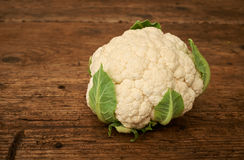 Fresh raw cauliflower on a kitchen bench. Royalty Free Stock Image