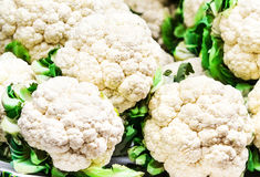 Fresh raw cauliflower on market close up. Royalty Free Stock Image