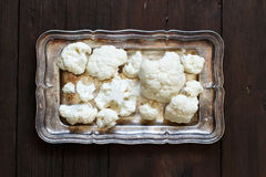 Fresh raw cauliflower. On an old wooden table top view Royalty Free Stock Image