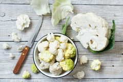 Fresh raw cauliflower. On an old wooden table top view Stock Image