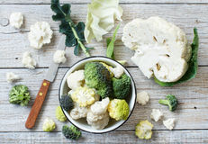 Fresh raw cauliflower. On an old wooden table top view Royalty Free Stock Images