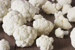 Fresh raw cauliflower. On wooden background, spread out the slices around the table Stock Photography