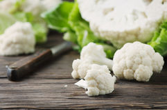 Fresh raw cauliflower on the wooden table. Selective focus Royalty Free Stock Photography