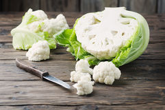 Fresh raw cauliflower on the wooden table. Selective focus Stock Photo