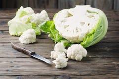 Fresh raw cauliflower on the wooden table Stock Photo