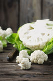 Fresh raw cauliflower on the wooden table. Selective focus Stock Image