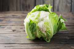 Fresh raw cauliflower on the wooden table. Selective focus Royalty Free Stock Photo