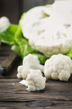Fresh raw cauliflower on the wooden table. Selective focus Royalty Free Stock Images