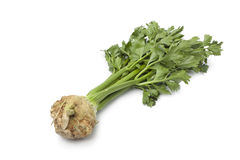 Fresh raw Celery root with green leaves Stock Photo