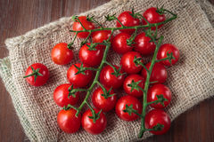 Fresh raw cherry tomatoes. Delicious fresh raw cherry tomatoes for an healthy nutrition Royalty Free Stock Images