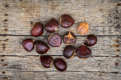 Fresh raw chestnuts. On a wooden background Stock Photos