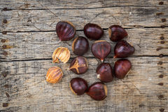 Fresh raw chestnuts. On a wooden background Royalty Free Stock Photo