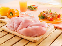 Fresh raw chicken breast arrangement. Fresh raw chicken breasts arrangement on kitchen cutting board Royalty Free Stock Images