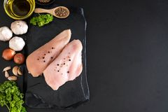 Fresh raw chicken breast fillet. With ingredient on black background Royalty Free Stock Photography