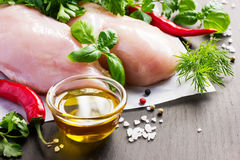 Fresh raw chicken breast,  spices and herbs Royalty Free Stock Photos