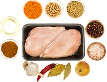 Fresh raw chicken breast with spices on white background Royalty Free Stock Photo
