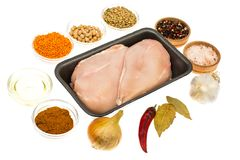Fresh raw chicken breast with spices on white background. Studio Photo Royalty Free Stock Image