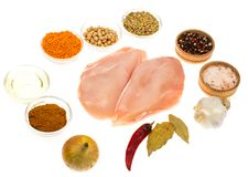 Fresh raw chicken breast with spices on white background. Studio Photo Stock Image