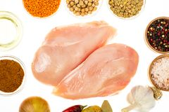 Fresh raw chicken breast with spices on white background. Studio Photo Stock Photography