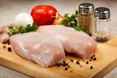 Fresh raw chicken breasts. On cutting board Stock Photos