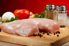 Fresh raw chicken breasts. On cutting board Stock Photo