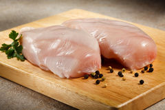 Fresh raw chicken breasts. On cutting board Stock Image