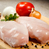Fresh raw chicken breasts. On cutting board Royalty Free Stock Image