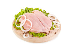 Fresh raw chicken breasts on chopping board. Clipping path included Royalty Free Stock Photo