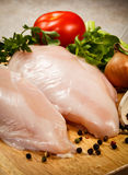 Fresh raw chicken breasts. On cutting board Royalty Free Stock Images