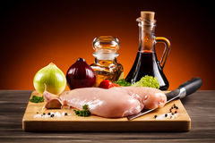 Fresh raw chicken breasts. On cutting board Stock Images