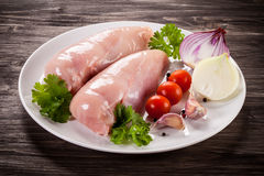 Fresh raw chicken breasts. On plate Royalty Free Stock Photo