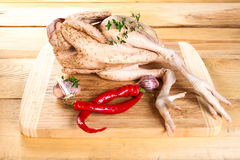 Fresh raw chicken carcass wooden board with pepper. Fresh raw chicken carcass on wooden board with pepper Stock Image