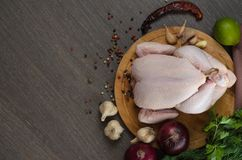 Fresh raw chicken composition on wooden background. Fresh raw chicken composition on a wooden background Royalty Free Stock Photo
