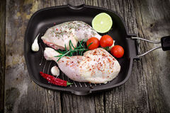Fresh raw chicken drumstick - raw chicken leg in pan. Raw chicken drumstick with spices (seasoning) in pan - chicken raw meat ready to prepare meal Stock Image